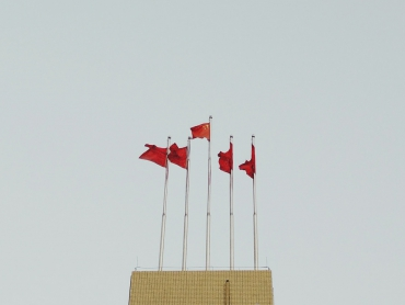 Chinese Flags in Front of Blue Sky