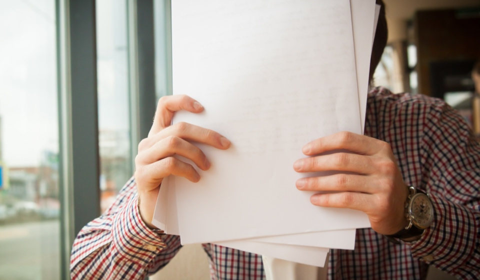 Person Holding Paper